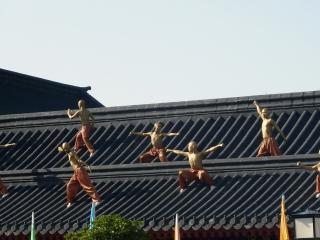 golden monks on roof